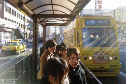 Streetcar arriving at Yubinkyokumae Station, Okayama, Japan Photo