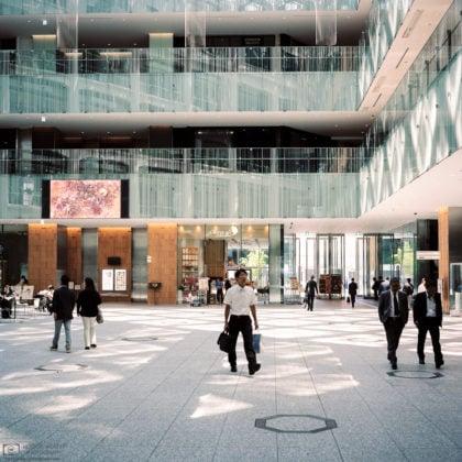 Striding across the JP Tower Lobby, Tokyo, Japan Photo