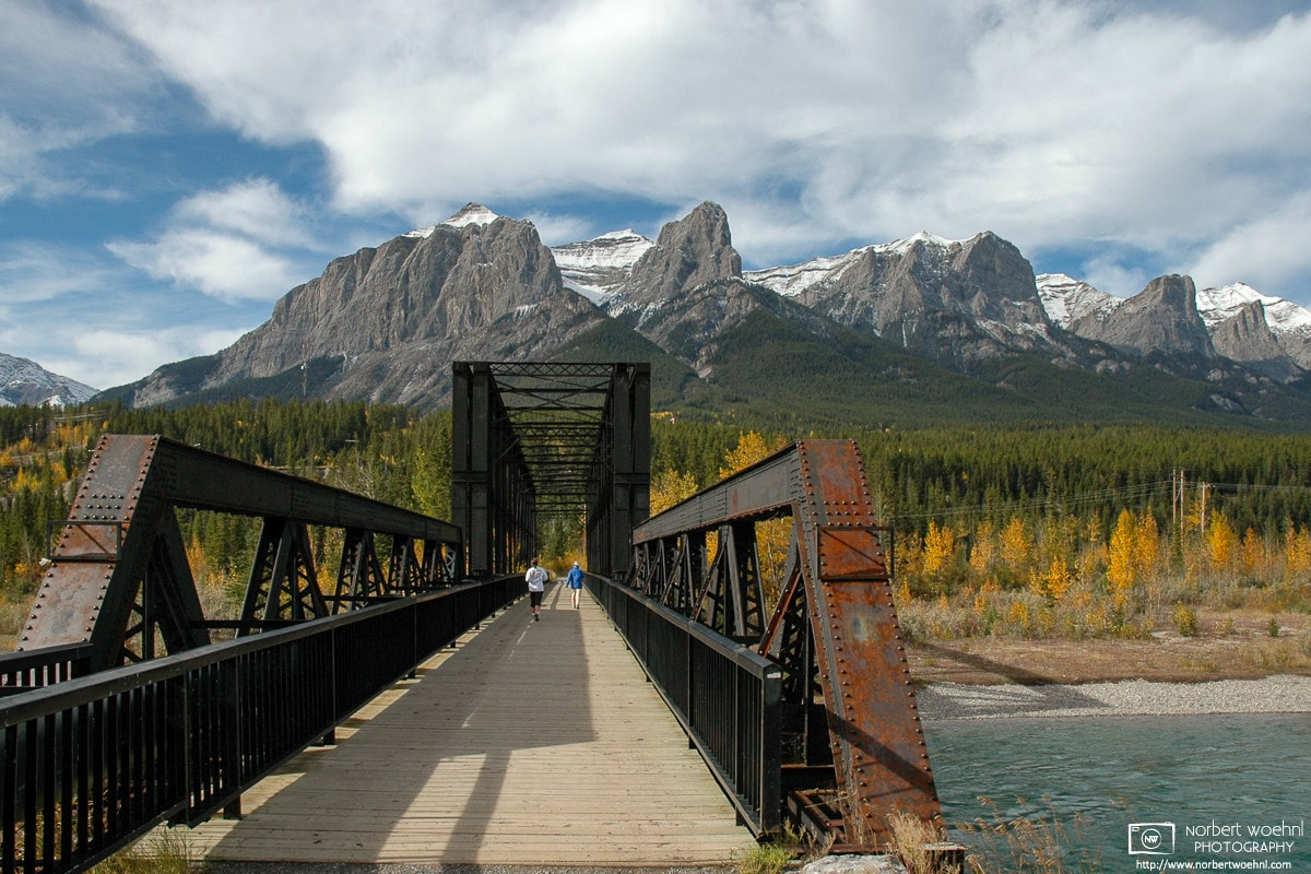 """The Canmore """"Engine Bridge"""" spans the Bow River in Canmore, Alberta, near the southwest boundary of Banff National Park."""