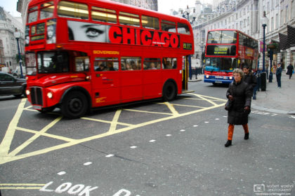 At Regent Street in London, England, a double decker bus is decorated with an eye-catching advertisement.