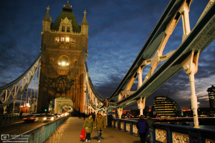 An evening walk across Tower Bridge in London, England. The City Hall (GLA Building) is visible in the background.