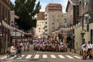 Participants at the Hakata Gion Yamakasa Festival are assembling outside Kushida Shrine in Fukuoka, Japan.