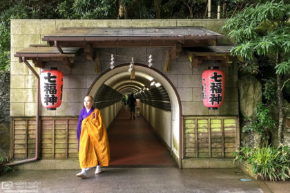 A priest is seen emerging from a pedestrian tunnel at Nanzoin Temple in Sasaguri, Fukuoka Prefecture, Japan.