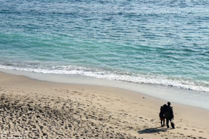 A contemplative seaside moment on the beach close to Kamakurakokomae Station in Kamakura, Japan.
