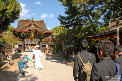 Students of different ages are visiting the grounds of Kitano Tenmangū Shrine (北野天満宮) in Kyoto, Japan.