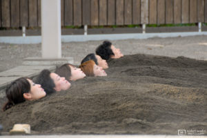 Customers are relaxing while taking a sand bath in Beppu, Oita Prefecture, Japan.