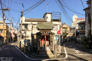 A small shrine in an old residential area around Ikebukuro Honcho in Tokyo, Japan.