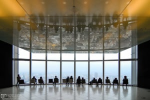 Visitors to the 52nd floor observation deck at Mori Tower in Roppongi, Tokyo, are enjoying a view of the city.