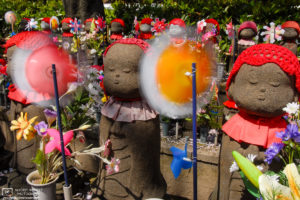 Jizo Statues at Zojoji Temple in Tokyo, Japan. Jizō is seen as the guardian of children - in particular, children who died before their parents - and is believed to help their souls reach paradise.