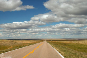 Endless prairies and fluffy clouds along State Highway 29 near Mitchell, Nebraska.