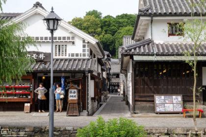 Scene on a street corner with restaurants in the historic Bikan district of Kurashiki in Okayama Prefecture, Japan.