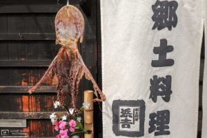 Dried Squid hanging outside an old shop in the Bikan Historical Area of Kurashiki in Okayama Prefecture, Japan.