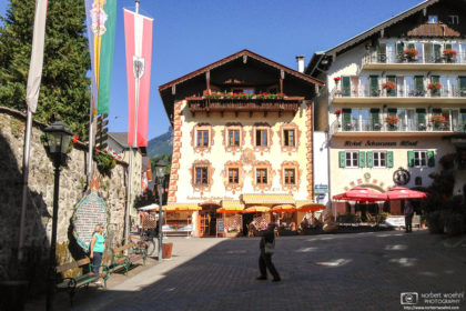 Visitors capturing memories in the beautiful historic town center of Sankt Wolfgang, Austria.