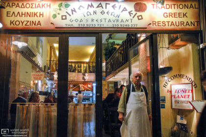 A candid shot of Giorgios Falias, owner of the Oinomageireio Restaurant in Athens, Greece.