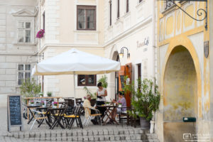 Folks enjoying a nice early-summer afternoon at a street café in the small town of Rust, Burgenland, Austria.