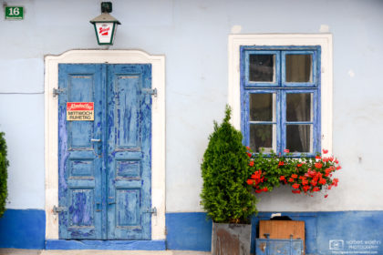 Multiple layers of blue paint on a beautiful exterior of an old pub at St. Margarethen in Burgenland, Austria.