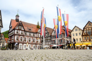 Cyclists enjoying a fine spring day on the historic Market Square of Bad Urach in Southwestern Germany.