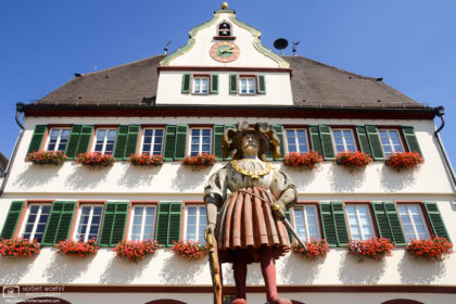 A view of the statue atop the 1537 Market Fountain in front of the City Hall of Weil der Stadt, Germany.