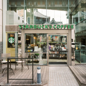 Standing outside this Starbucks in Kyoto, Japan, I noticed Rokkakudo Temple making a discrete appearance in the background.