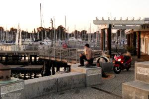 A biker enjoying the sunset at the Santa Cruz Small Craft Harbor in Santa Cruz, CA.