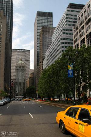 A NYC taxi is seen moving away from the MetLife Building in New York City, USA.