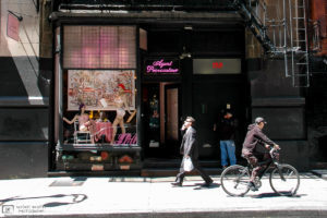 """Passersby outside the """"Agent Provocateur"""" store on Mercer Street in Soho, New York City, USA."""