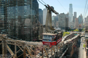 A Roosevelt Island Tramway capsule is seen against the Upper East Side of Manhattan, New York, USA.