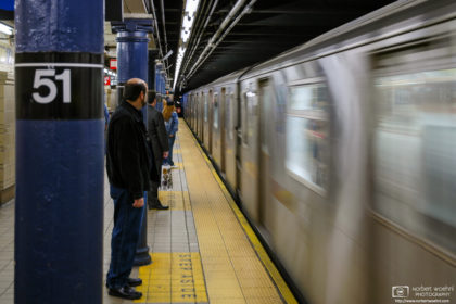 The E Train is seen arriving at Lexington Ave/51st Street Subway Station in Manhattan, New York, USA.