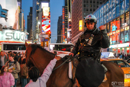 A policeman is seen navigating early-evening traffic on top of a horse on Times Square in New York City, USA.