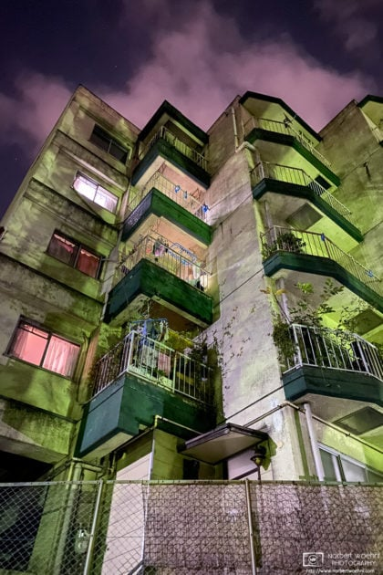 A nighttime view of an apartment building near Mitsugi Park in Itabashi-ku, Tokyo, Japan.