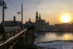 A winter view of Augustus Bridge spanning the Elbe River into the old town of Dresden, Germany.