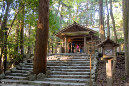 Visitors are seen in prayer at Aramatsuri-no-miya, an affiliated shrine inside Ise Jingu in Mie Prefecture, Japan.