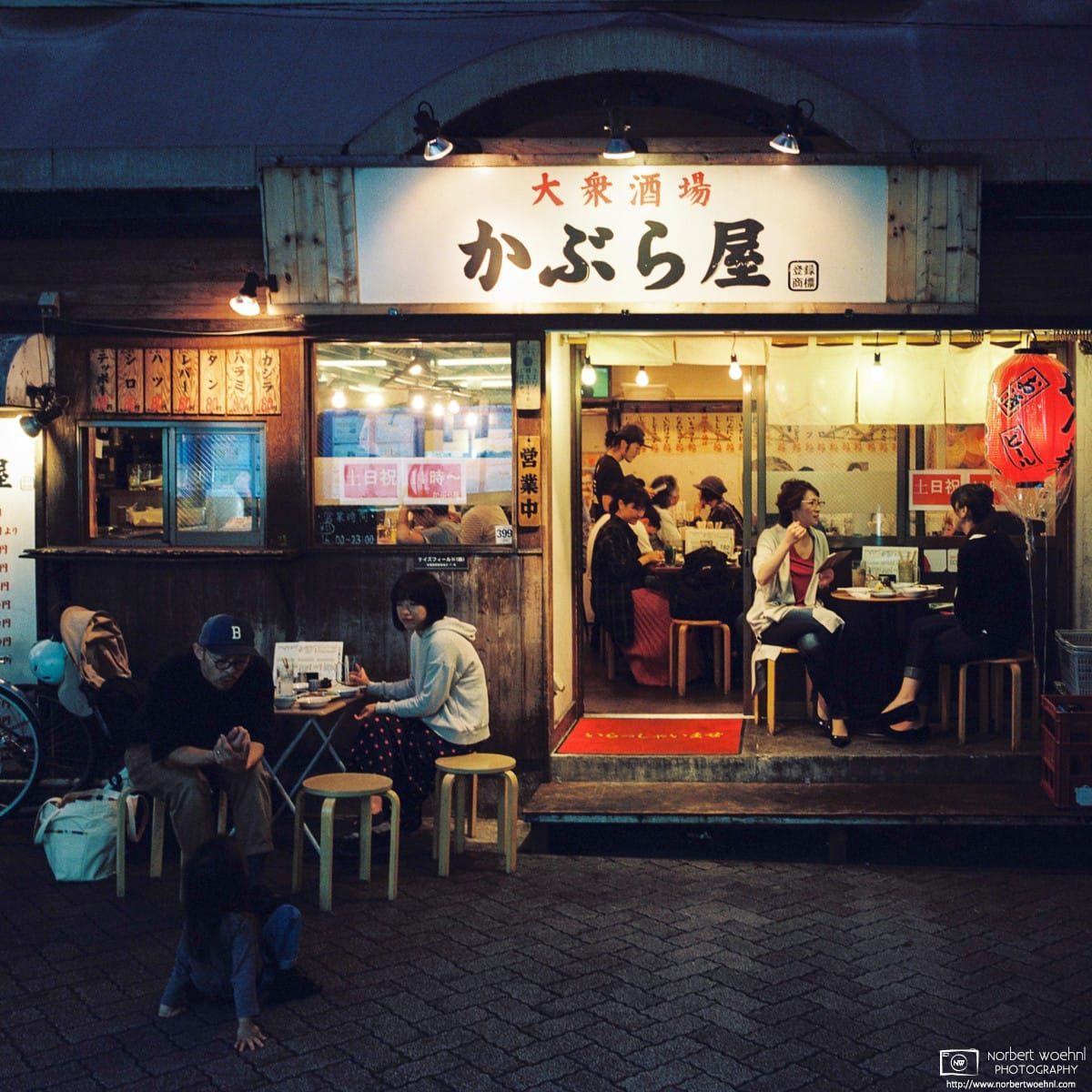 Patrons enjoying a nice autumn evening at an Izakaya (Japanese-style pub) in Asagaya, Tokyo, Japan.