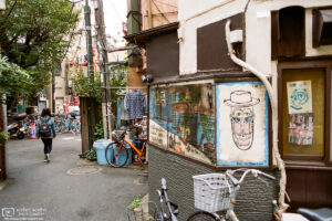 A makeshift exhaust pipe and a brick-pattern shirt are just two of the many details to be found in this scene from a street corner in Nakano, Tokyo, Japan.