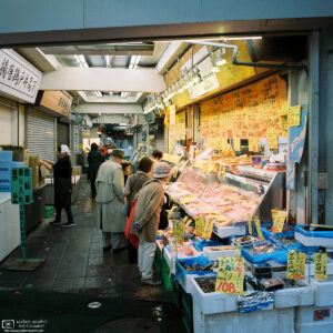 Customers are looking at meat and seafood offered by this shop in Shimo-Takaido, Setagaya, Tokyo, Japan.