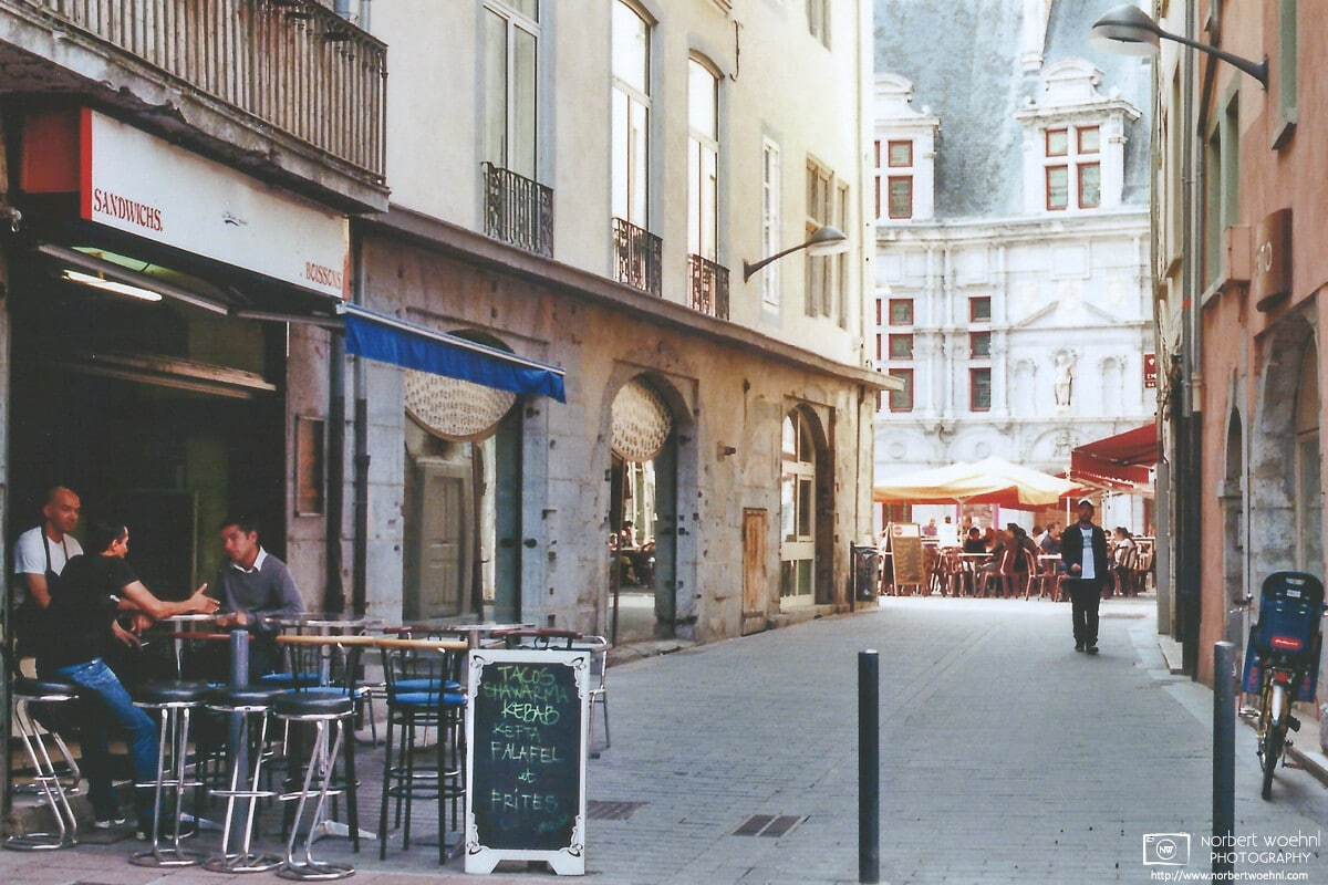 Afternoon scene from a side street in the historic city center of Grenoble, France.