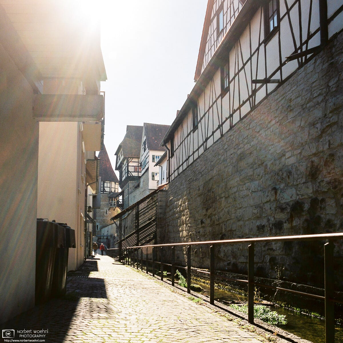 Bright rays of sunlight at Little Venice, a pleasant area along the old town wall of Balingen, Germany.