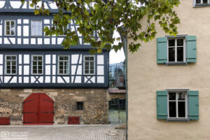 A study of old architecture in the southwest-German city of Reutlingen. The building at the left is the main building of Friedrich List Gymnasium, dating back to the 16th century.
