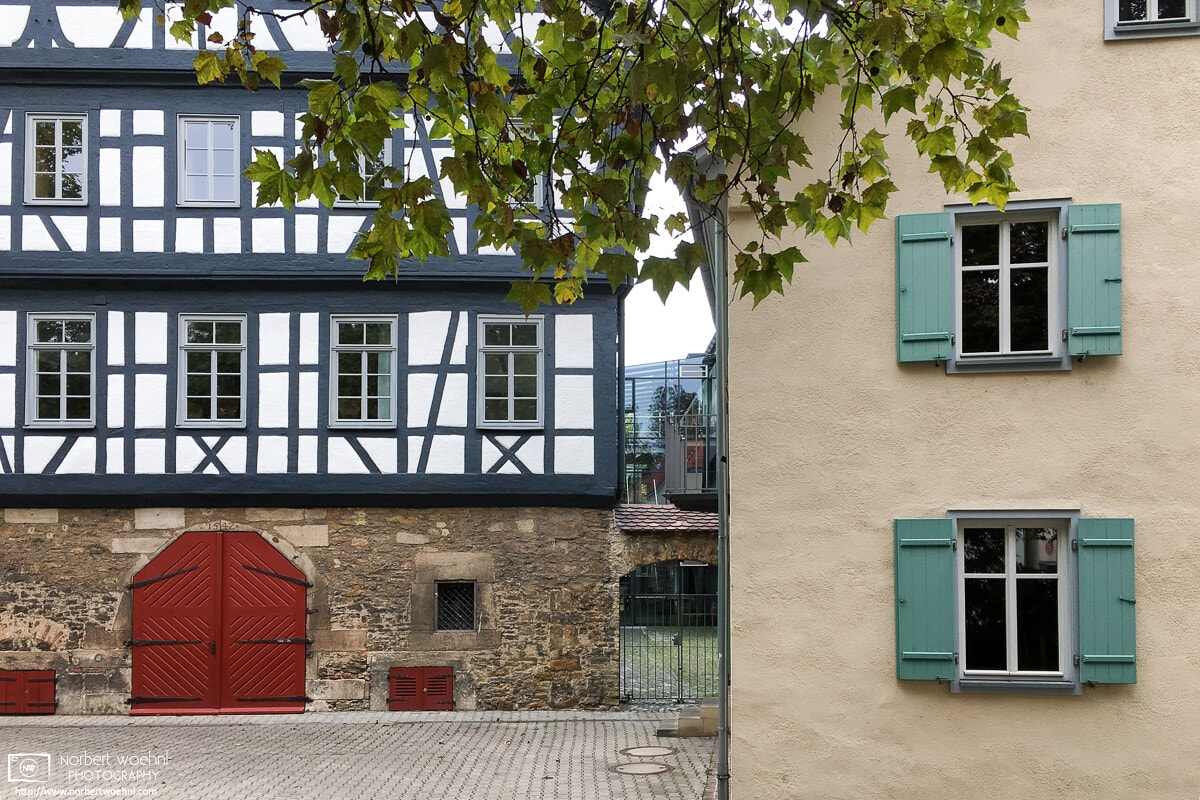 A study of old architecture in the southwest-German city of Reutlingen. The structure at the left is the main building of Friedrich List Gymnasium, dating back to the 16th century.
