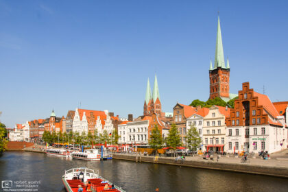 A view towards the old city center of Lübeck, Germany, from a tour boat on the Trave River.