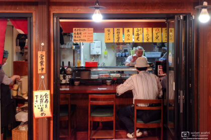 View into a small seafood restaurant inside Omicho Market in Kanazawa, Japan.