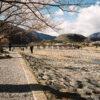 A view along Katsura River in Arashiyama, Kyoto, Japan. Togetsukyo Bridge is visible in the background.