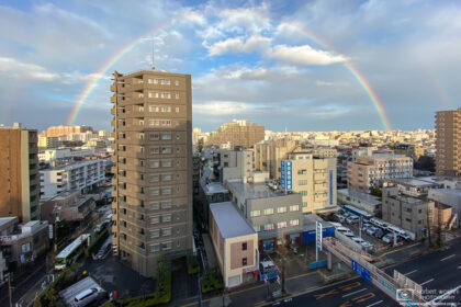 Towards the end of a rain-filled day, a rainbow rises over the eastern part of Itabashi-ku in Tokyo, Japan.