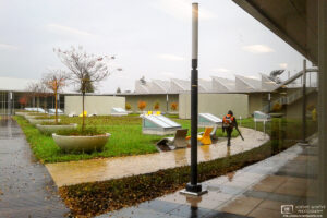 Blowing the autumn leaves on a rainy day in the inner yard of a corporate site in Palo Alto, California.