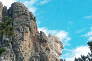 National Park staff inspecting the head of George Washington at Mount Rushmore, South Dakota.
