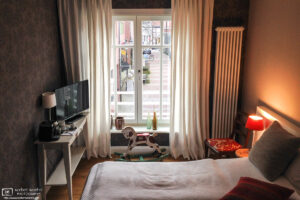 A cozy hotel room interior at the Hotel No. 11 in Lüdinghausen, Germany.