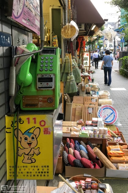 An old-style payphone outside a household goods shop in Ningyocho, Tokyo, Japan.