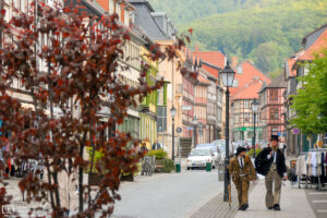 Traveling carpenter journeymen are walking the streets of the old city of Wernigerode, Germany.