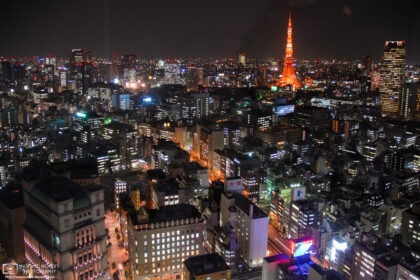 View towards an illuminated Tokyo Tower from a hotel room at the Park Hotel Shiodome in Tokyo, Japan.