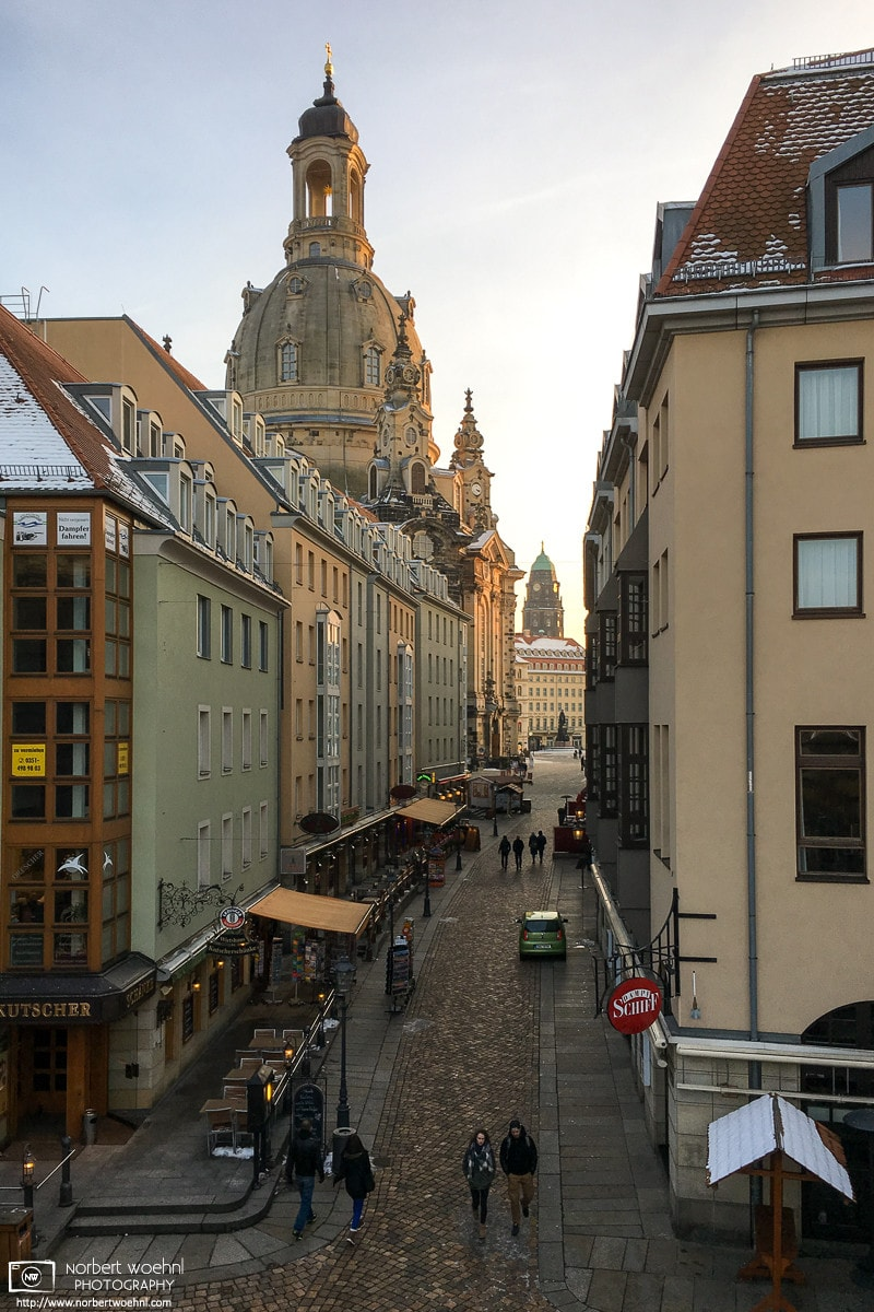 A southbound view along Münzgasse towards the dome of Frauenkirche in Dresden, Germany. The darker tower in the back is part of the new City Hall (Neues Rathaus).
